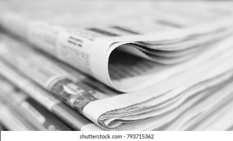 Stack of newspapers. Folded pages with news, selective focus on paper