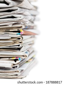 Stack of newspapers isolated on white.