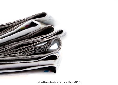 Stack of newspapers on white background. Shallow DOF. Copy space