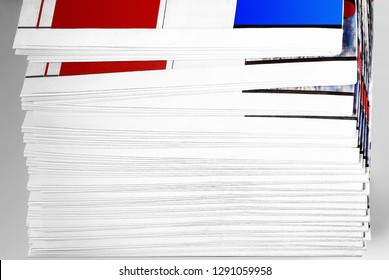 Stack of Newspapers over gray background
