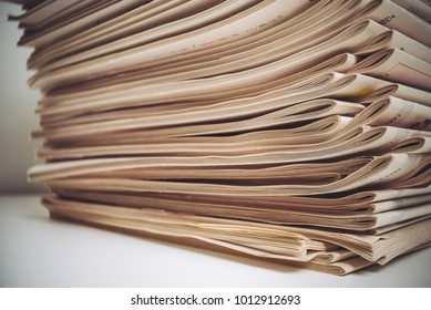 Stack of newspapers placed on white background