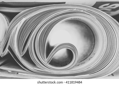 Stack of newspapers rolls, selective focus