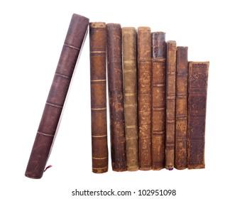 Stack of nine antique books, isolated white background