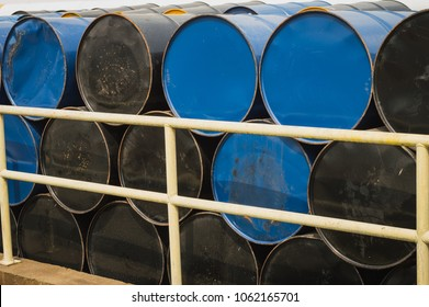 stack of oil drums,Used 55 gallon chemical drums in a storage yard awaiting recycling.At the industrial event is a warehouse of  barrels of hydrocarbons.