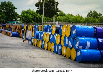 stack of oil drums,Used 55 gallon chemical drums in a storage yard awaiting recycling.At the industrial event is a warehouse of barrels of hydrocarbons.Industry oil barrels .