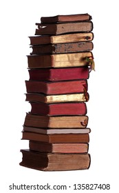 stack of old books with red and golden pages