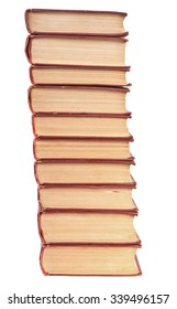 stack of old books with yellowed pages isolated on white background