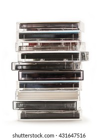 Stack of old cassettes on white background