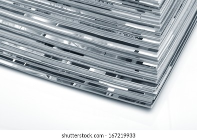 Stack of old colored magazines on white background. Monochrome