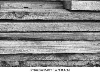 Stack of old dirty planks. Black and White. Close up.