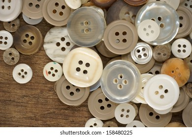 Stack of old fashioned brown beige and white buttons