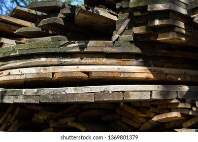 Stack of old firewood texture background. Firewood for the winter, stacks of firewood, pile of firewood.
