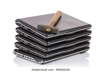 stack of old laptops awaiting repair isolated on white background