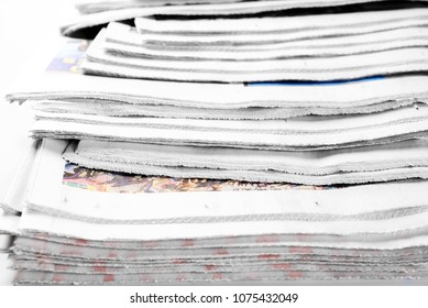 Stack of old newspapers, selective focus
