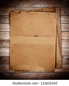 stack of old papers on wood textures background
