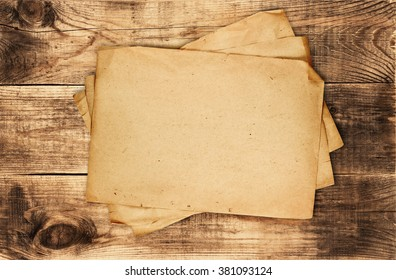 Stack of old papers on wooden table