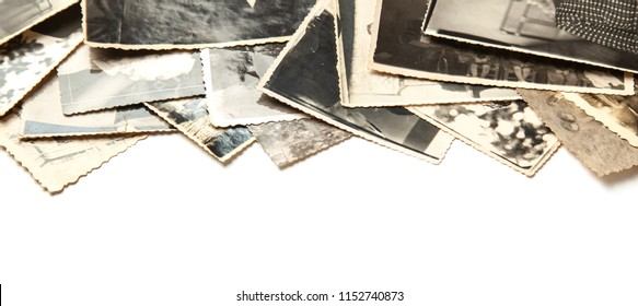 Stack old photos isolated on white background. Postcard rumpled and dirty vintage. Retro card