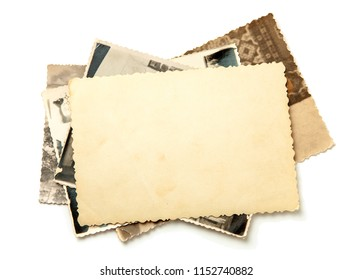 Stack old photos isolated on white background. Mock-up blank paper. Postcard rumpled and dirty vintage. Retro card