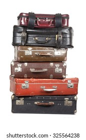 Stack of old suitcases isolated