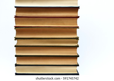 Stack of old thick books on a white background