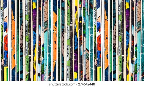 Stack of old vintage comic books background texture