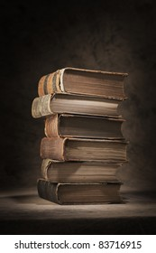 A Stack of old worn and tattered books.