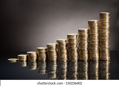 Stack Of One Euro Coins Over Black Background