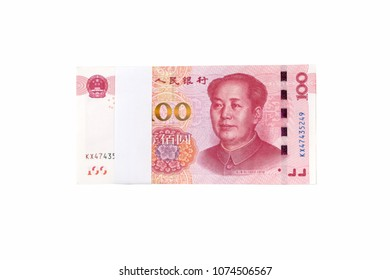 Stack of one hundred chinese yuan bills isolated on white background. Chinese currency banknotes.
