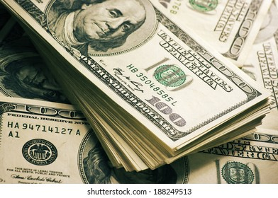Stack of one hundred dollar bills close-up.