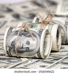 Stack of one hundred dollar bills. Square crop photo for social media.