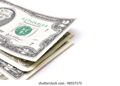 stack of one hundred dollar bills U.S. on white background
