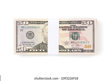 Stack of one hundred US Dollar money bills isolated on white background with clipping path. Pile of dollar currency banknotes.
