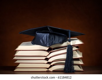 Stack of opened books and graduation cap, for various education,graduation or knowledge themes
