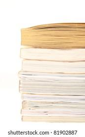stack of opened magazines isolated on white