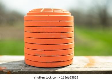 Stack of orange clay pigeons