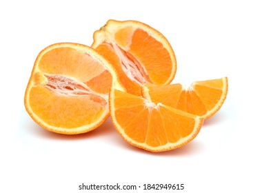 Stack orange tangerine or Mineolas with slices and leaf isolated on white background