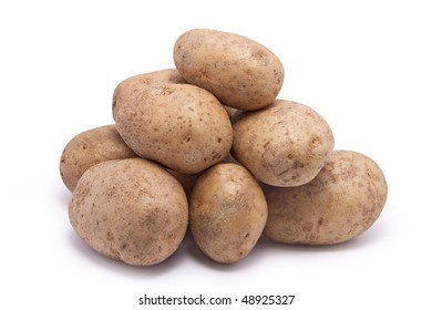 A stack of ordinary raw potatoes.  On white background.