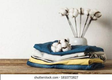 A stack of organic clothing and cotton colors. Eco friendly fabric shop.