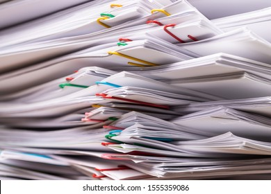 Stack overload document report paper with colorful paperclip place, business and paperless concept.
