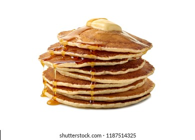 Stack of pancakes with butter and a flowing maple syrup on white