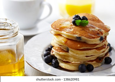 Stack of pancakes with fresh blueberry