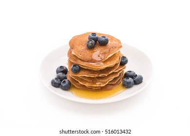 Stack of pancakes with fresh blueberry on white background