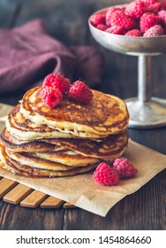 Stack of pancakes with fresh raspberries close-up