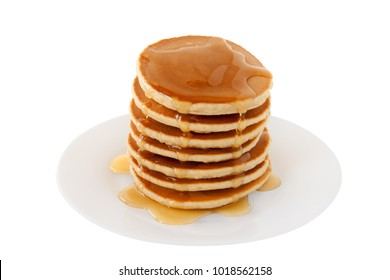 Stack of Pancakes with maple syrup on a plate isolated white background. Fat Tuesday. Dessert. Snacks. Family Breakfast. Brunch. Food. Sweets.