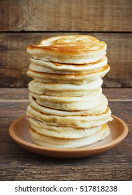 stack of pancakes on a old wooden background rustic