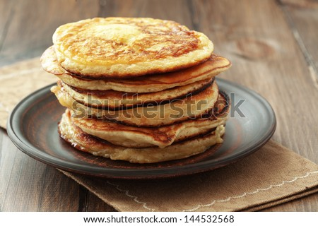 Stack of pancakes on vintage white wooden background
