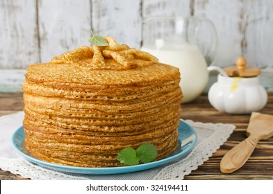 A stack of pancakes on a wooden table. Shrove Tuesday