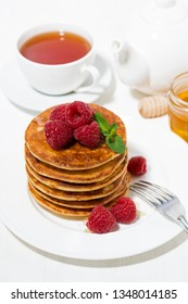 stack of pancakes with raspberries for breakfast, top view