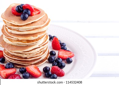 stack of pancakes with strawberry and blueberry