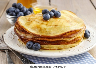 Stack of pancakes with syrup and blueberries
